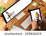 woman working on tablet placed... | Shutterstock . vector #245826319