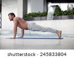 man at the gym doing stretching ... | Shutterstock . vector #245833804