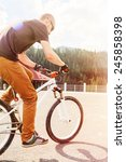 young man jump on bicycle... | Shutterstock . vector #245858398