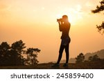 Silhouette Female Photographer...