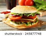 fresh burger on grey wooden... | Shutterstock . vector #245877748