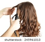 stylist using curling iron for... | Shutterstock . vector #245961013