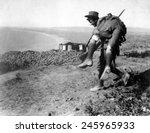An Australian Soldier Carrying...