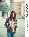 young beautiful woman in town... | Shutterstock . vector #246008989