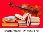 Violin And Books On A Red...
