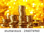 golden coins stacks on bright...