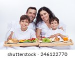 happy family having breakfast... | Shutterstock . vector #246122770