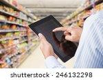 businessman checking inventory...   Shutterstock . vector #246132298