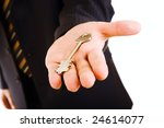 key in a palm of a businessman | Shutterstock . vector #24614077