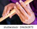 Man Playing Bamboo Flute...
