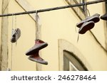 Old Sneakers Hanging From A...
