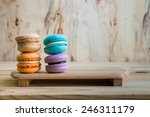 Macarons On Table Over Wooden...