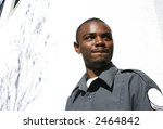 Grimacing african american security guard - stock photo