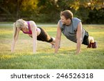 happy young couple exercising... | Shutterstock . vector #246526318
