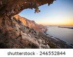male rock climber climbing on a ... | Shutterstock . vector #246552844