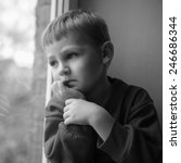 small boy sitting near window... | Shutterstock . vector #246686344