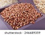 groats in wooden box closeup | Shutterstock . vector #246689359