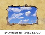a hole in a wall with blue sky | Shutterstock . vector #246753730