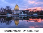 Stock photo winter sunrise at the illuminated us capitol in washington dc mirrored in the reflecting pool with 246883750