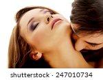 handsome man kissing woman's... | Shutterstock . vector #247010734