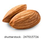 two almonds nuts isolated on... | Shutterstock . vector #247015726
