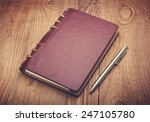 notebook and pen on wood... | Shutterstock . vector #247105780