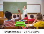 pupils raising their hands... | Shutterstock . vector #247119898