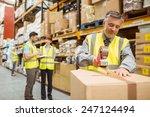 warehouse worker sealing... | Shutterstock . vector #247124494