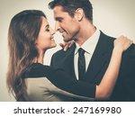 happy smiling couple in suit... | Shutterstock . vector #247169980