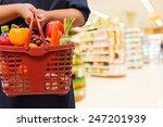 woman holding shopping basket... | Shutterstock . vector #247201939