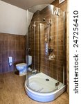 Interior of a modern bathroom. Shower cabin, basins, toilet. The vertical position photo. - stock photo