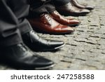 Men's Legs In Shoes On The...