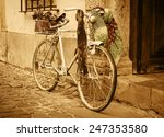 vintage bicycle leaning against ... | Shutterstock . vector #247353580