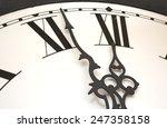 Clock With Swirly Black Hands...