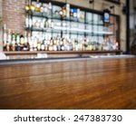 Stock photo top wooden table with bar blurred background 247383730