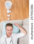 man resting on couch with... | Shutterstock . vector #247442386