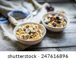 oatmeal with berries and nuts | Shutterstock . vector #247616896
