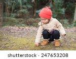 Children Pick Up The Acorns