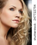 Young Beautiful Woman Looking...