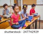 pupils meditating in lotus... | Shutterstock . vector #247742929