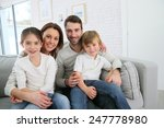 cheerful family at home sitting ... | Shutterstock . vector #247778980