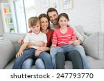 cheerful family at home sitting ... | Shutterstock . vector #247793770