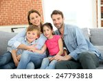 cheerful family at home sitting ... | Shutterstock . vector #247793818