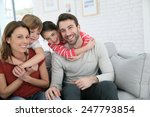 cheerful family at home sitting ... | Shutterstock . vector #247793854