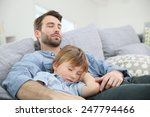 father and son taking a nap on... | Shutterstock . vector #247794466