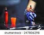 tattooist makes a tattoo.... | Shutterstock . vector #247806298