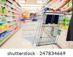 woman pushing shopping cart in...   Shutterstock . vector #247834669