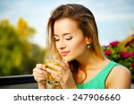 Stock photo young woman drinking green tea outdoors summer background shallow depth of field 247906660