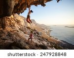 young woman lead climbing on... | Shutterstock . vector #247928848