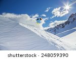 skier skiing downhill in high... | Shutterstock . vector #248059390